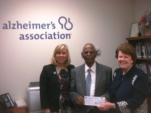 Dr. Inder Kumar presents a donation to Elaine Sproat, President & CEO of the Hudson Valley Chapter of the Alzheimer's Association, along with Elizabeth Rowley, President & CEO of The Community Foundation of Orange and Sullivan.